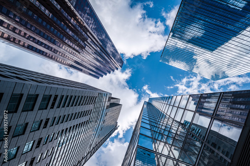 Business and finance concept, looking up at modern office building architecture in the financial district, Toronto, Ontario, Canada.