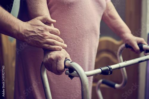 Fototapeta Senior doctor helping his patient to walk obraz