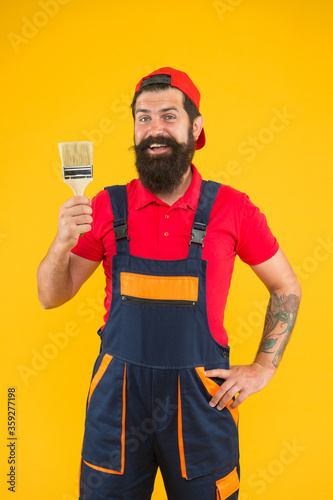 Bearded mature man painter. Furniture restoration. How to Refinish Furniture. Clean repair and restore old worn finishes. Furniture makeover. Construction and renovation. Decoration and decor Wall mural