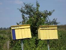 "Collective Free-standing Yellow Mailboxes With Inscription ""POST"" (In Polish ""POCZTA""), The Village Of Tuja, Pomeranian Voivodeship, Poland"
