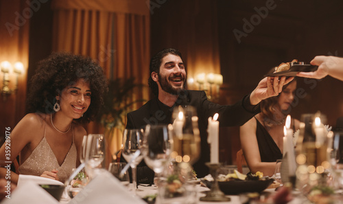 Group of friends having a dinner party at nightclub - 359289176