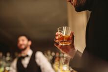 Man Having A Drink At Bar