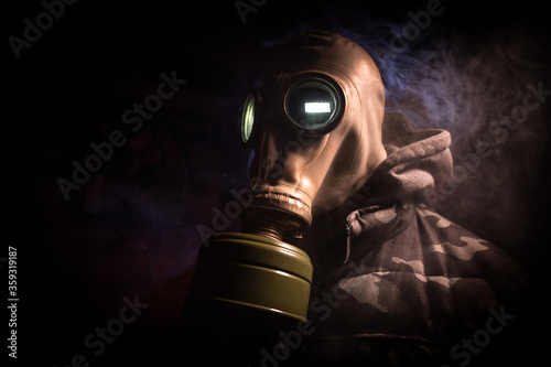 Gas mask with clouds of smoke on a dark background Canvas Print