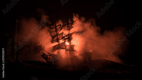 Canvas Print Black silhouette of the pirate ship in night