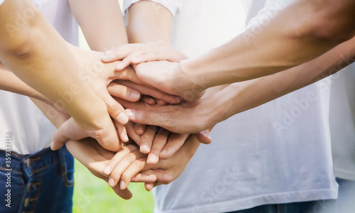 Fototapeta Power of male and female volunteer charity work. Stack of people hand. Team teamwork business join hand together concept obraz