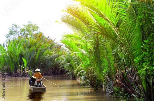 People boating in the delta of Mekong river, Vietnam Fototapete