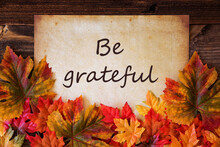 Grungy Old Paper With English Text Be Grateful. Colorful Autum Decoration With Leaves
