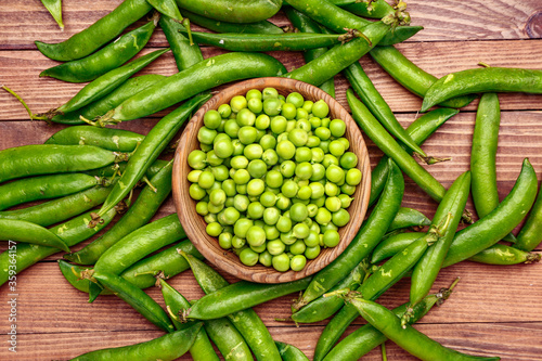 Plate with tasty fresh peas on table
