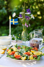 Fresh Smoked Salmon Salad And Other  Swedish Midsummer Solstice Traditional Food On A Table Outdoors