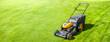 Leinwanddruck Bild - Lawn mower on fresh green lawn, freshly cut grass on summer sunny day, banner