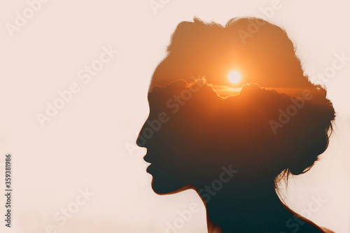 Fototapeta Woman with sun over clouds in her head. Mental health concept obraz na płótnie