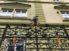 Ornate Metal Fence With Figuri...