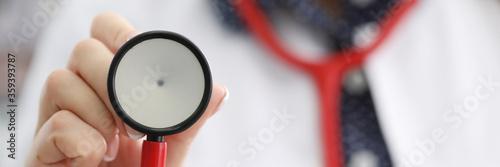 Obraz na plátně Doctor in white coat shows stethoscope membrane