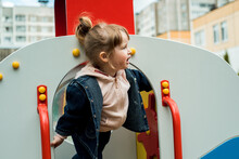 Little Girl On The Playground....