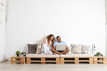 Couple Looking At Laptop In Th...