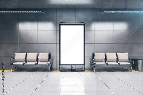 Fotografia Chairs and blank banner in modern underground railway station