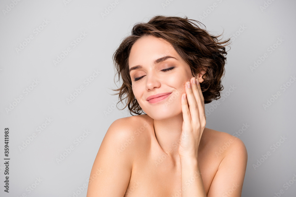 Fototapeta Portrait of positive lovely pretty girl touch hand face enjoy her soft pure perfect skin after bodycare plastic surgery treatment isolated over grey color background