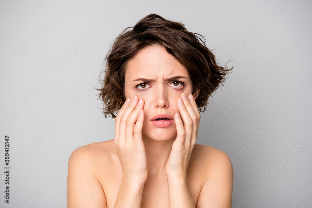 Fototapeta Closeup photo of beautiful naked lady bobbed hairstyle look mirror displeased touch cheekbones under eye bags overworked terrible skin condition isolated grey color background