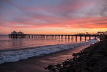Malibu Pier Sunset Near Los Angeles On The Southern California Coast.