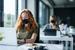 canvas print picture - Young people with face masks back at work or school in office after lockdown.