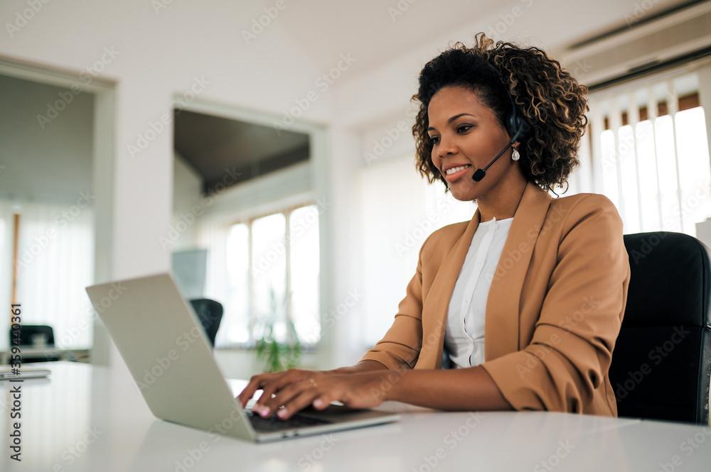 Fototapeta Close-up portrait of a customer service agent at work.
