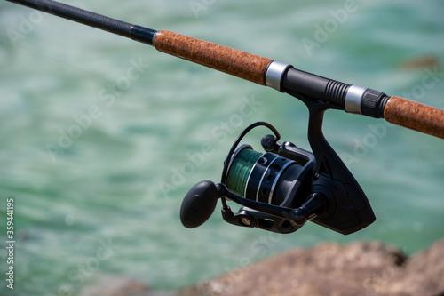 Fototapeta close up  A fishing rod of a fisherman for fishing at the river obraz