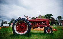 Old Red Tractor On A Farm
