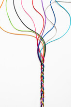 Coloured String Woven Together To Illustrate Concepts Of Unity Society Togetherness And Cooperation