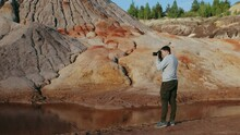 Photographer Taking Pictures On Beautiful Hilly Landscape