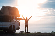 Adventurer Man In Journey Travel With Off Road Car And Roof Tent To Enjoy Freedom And Explorer Concept. Discover The World Living Near The Power Of The Nature.