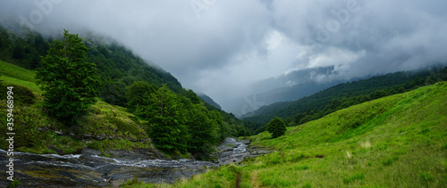 Fotografija Panoramic view on a bad weather day from the top of the mountain on The Valley o