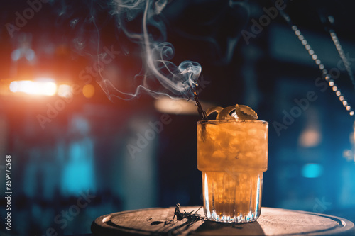 Cuadros en Lienzo scottish bee cocktail with smoke on blue background