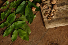 Walnuts And Leaves On A Wooden...