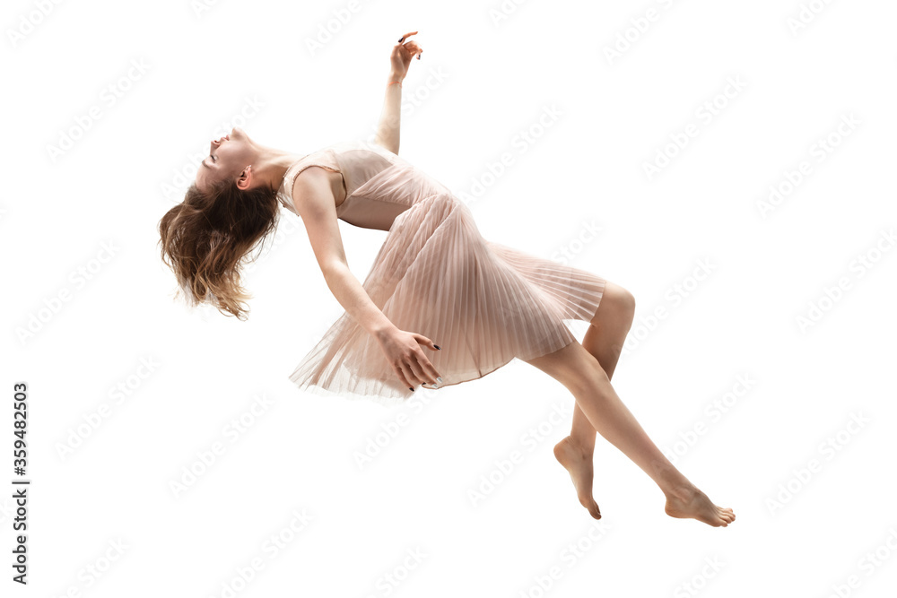 Fototapeta Mid-air beauty cought in moment. Full length shot of attractive young woman hovering in air and keeping eyes closed. Levitating in free falling, lack of gravity. Freedom, emotions, artwork concept.