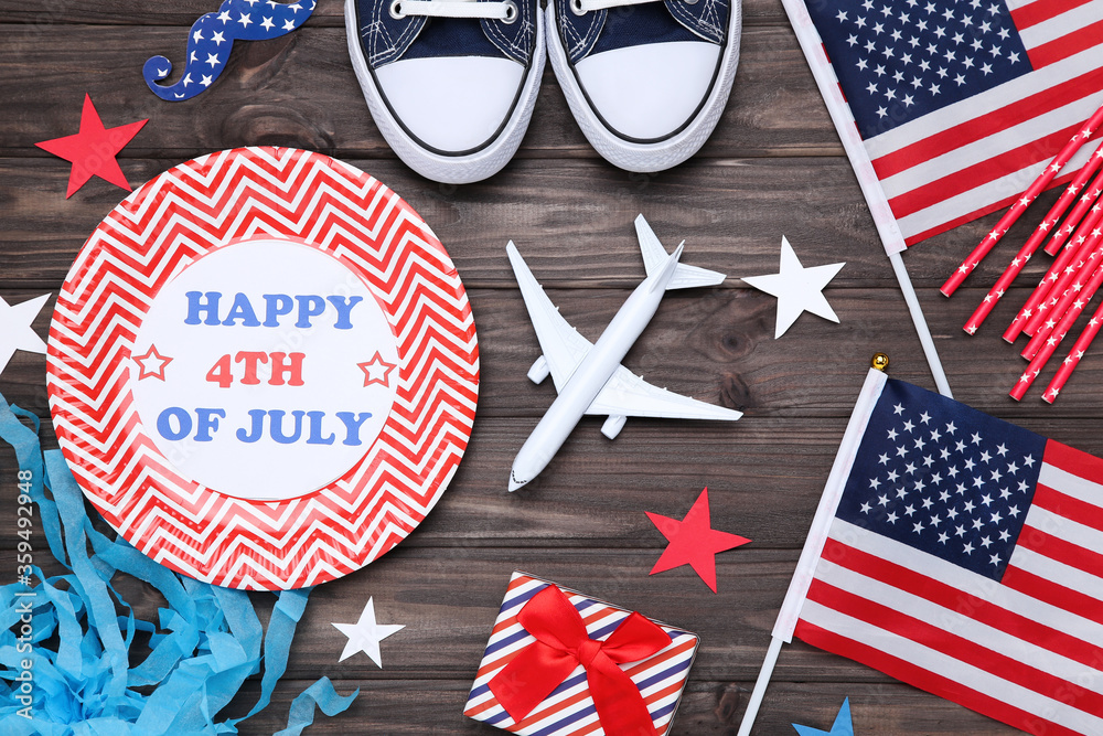 Fototapeta Text Happy 4th of July with flags, gift box, airplane model and paper stars on wooden table