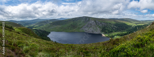 Fotografia, Obraz Panoramic view of  The Guinness Lake (Lough Tay) -  a movie and series location, such as Vikings