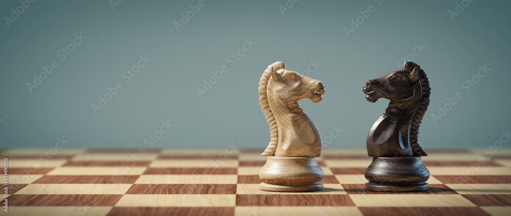 Fototapeta Knights on a chessboard. Business, strategy, conflict and leadership concept.