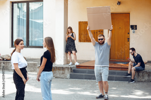 Dude with sign - man stands protesting things that annoy him Canvas Print