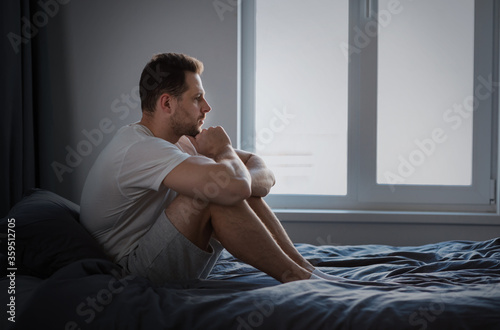 Obraz Anxious Man Thinking About Problems Sitting In Bed Indoors - fototapety do salonu