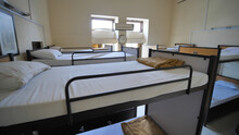 Empty Room For A Cheap Hostel With Bunk Beds.