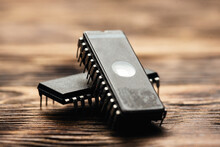 Old Microcircuit On A Table Close Up.
