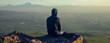 traveling man sitting in rock in mountain