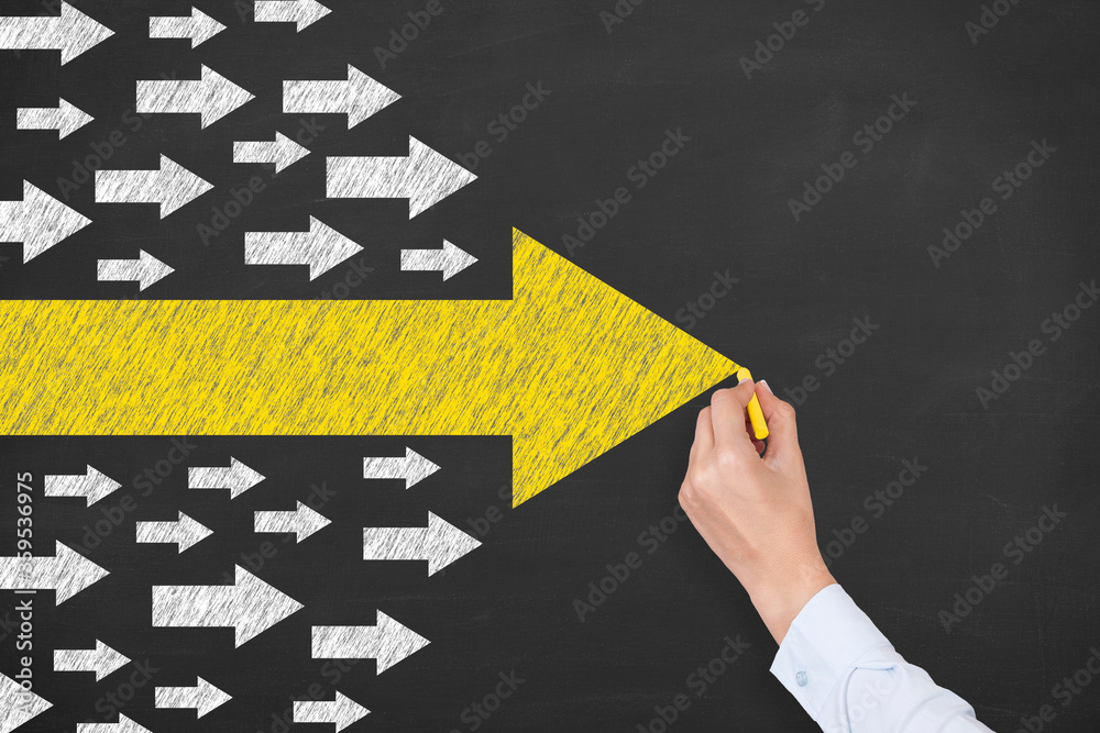 Fototapeta Leadership Concepts with Arrows on Chalkboard Background