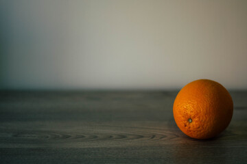 Conceptual background with an orange and an empty place for inscription