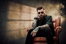 Cool Bearded Young Man Sitting...