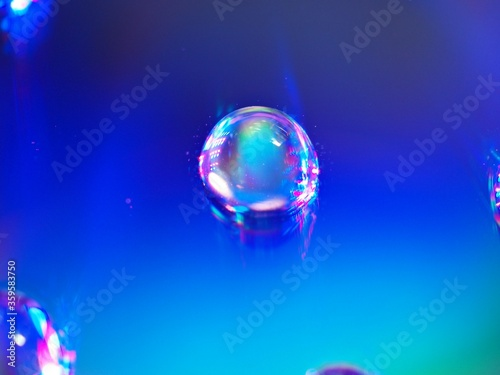 Fototapeta blurred water droplets with blue light on bright backgronud, dark and shiny , abstract background, macro image for card design obraz na płótnie
