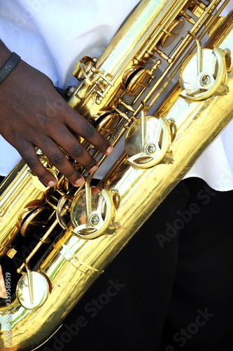 Baritone sax player in concert outdoors. Canvas Print