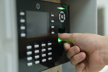 A Hand Using Fingerprint Scann...