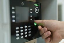 A Hand Using Fingerprint Scanner With Thumb Finger
