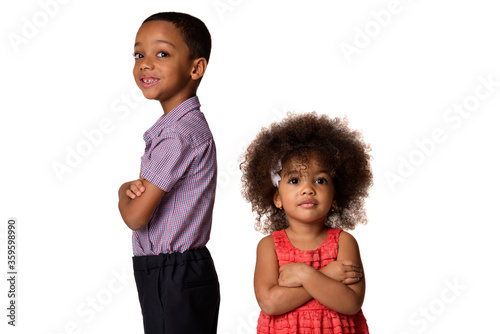 Fotografia childhood and people concept-two smiling african american siblings standing back